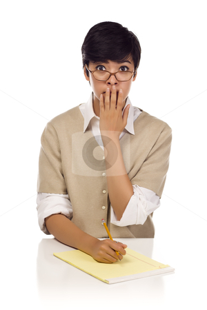 Shocked Mixed Race Young Adult Female Student at Table stock photo, Shocked Mixed Race Young Adult Female Student at Table with Pad of Paper and Pencil Isolated on a White Background. by Andy Dean