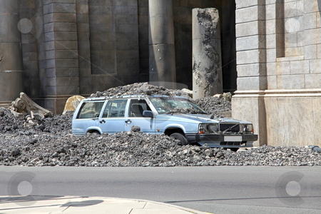 Car Crash stock photo, A car crashed in amongst concrete rubble by Lucy Clark