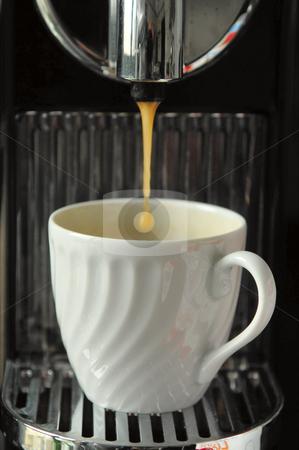 Pouring espresso stock photo, coffee cup at espresso machine by João Almeida