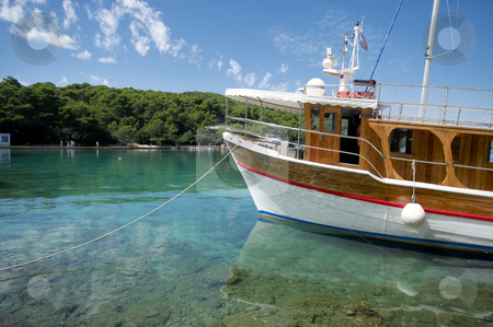 Ship in clear waters stock photo, Anchored ship in clear waters of the Mediterranean Sea by João Almeida