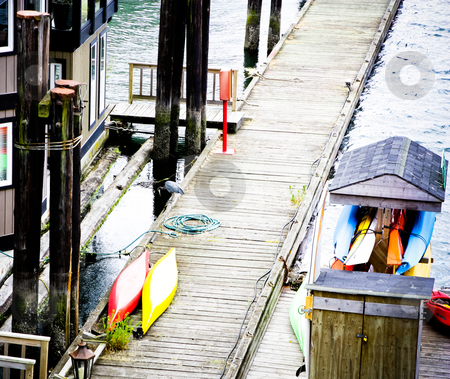Footbridge stock photo, lake footbridge view from above, with water poles and kayaks by Anatoliy Nykilchyk