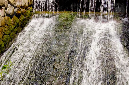 Small waterfall. stock photo, Water falling and flowing. Nice waterfall and old stones view. by sauletas