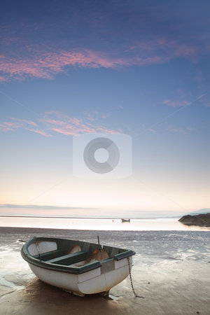 Small boat laying on beach just before sun rise stock photo, small boat laying on the beach just before sunrise blue sky and some clouds at Dingle peninsula Ireland by Dirk Ercken