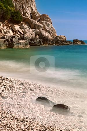 Rocky beach high cliffs blue sea  stock photo, rocky beach high cliffs blue sky and sea Sardinia Italy sardegna tourism and travel by Dirk Ercken