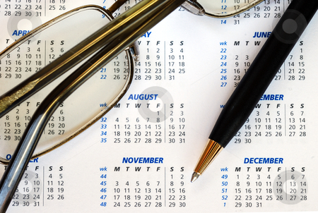 Check out the dates in a business calendar concepts of planning ahead stock photo, Check out the dates in a business calendar concepts of planning ahead by johnkwan