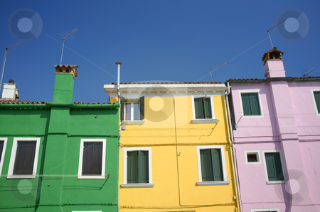 Burano houses stock photo, Burano is situated 7 kilometers from Venice. Burano is known for its small, brightly-painted houses. by Stocksnapper