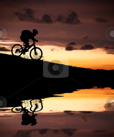 Silhouette of mountain biker with Reflection and sunset stock photo, silhouette of mountain biker with Reflection and sunset by tomwang