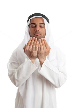 Arab man with open palms praying stock photo, An arab middle eastern man dressed in traditional rob and headdress with open hands praying. by Leah-Anne Thompson