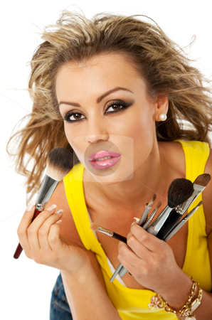 Female makeup stock photo, beautiful young woman is preparing to apply makeup by vilevi