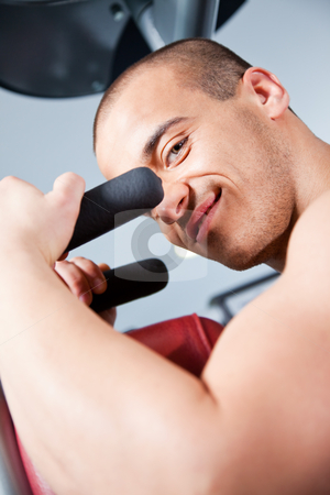 Attractive male training stock photo, Close-up of an attractive male working out at the gym, looking at the camera by vilevi