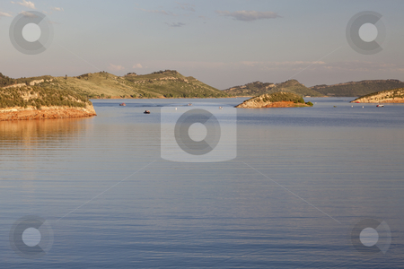 Summer on a mountain lake stock photo, recreation boats on Horsetooth Reservoir near Fort Collins, Colorado, summer afternoon by Marek Uliasz