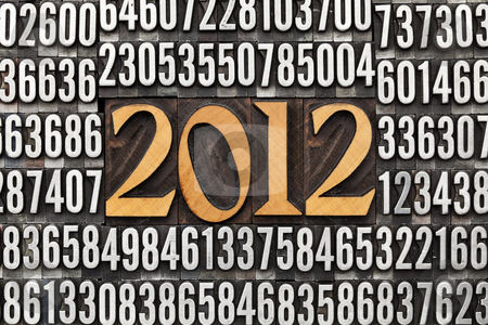 Year 2012 in letterpress type stock photo, 2012 number in vintage wood letterpress printing blocks surrounded by random metal numbers by Marek Uliasz