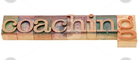 Coaching word stock photo, coaching  - isolated word in vintage wood letterpress printing blocks by Marek Uliasz