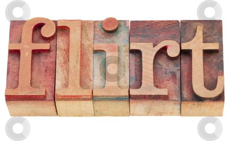 Flirt in letterpress type stock photo, isolated word in vintage flirt - wood letterpress printing blocks by Marek Uliasz