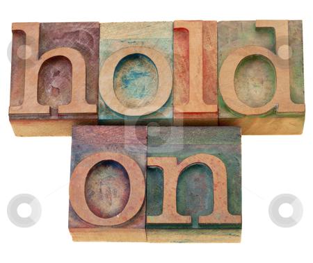 Motivational concept - hold on stock photo, motivational concept - hold on - isolated phrase in vintage wood letterpress type by Marek Uliasz