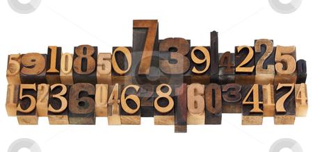 Random numbers in letterpress type stock photo, numerical concept - two rows of random numbers - isolated vintage wood letterpress printing blocks by Marek Uliasz