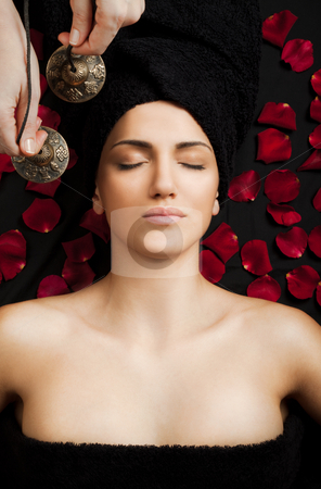 Female sound therapy stock photo, Beautiful female receiving energy sound massage in spa, eyes closed by vilevi