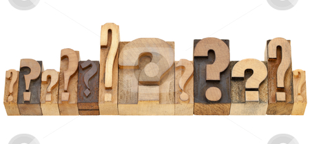 Question marks stock photo, decision making concept - a row of question marks - vintage wood letterpress printing blocks by Marek Uliasz