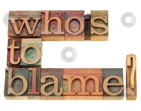 Who is to blame question stock photo, responsibility concept - who is to blame question - isolated text in vintage wood letterpress printing blocks by Marek Uliasz