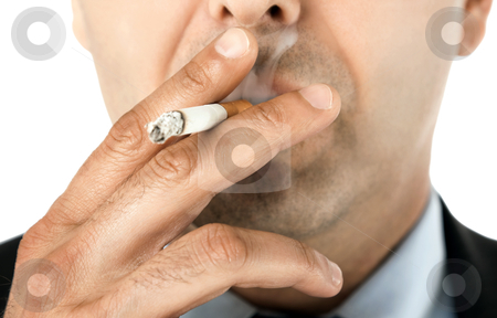 Smoker stock photo, Close-up of man face holding cigarette and smoking by vilevi