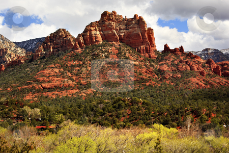 Camel Head Orange Red Rock Butte Sedona Arizona stock photo, Camel Head Orange Red Rock Butte Canyon Houses Blue Cloudy Sky Green Trees Sedona Arizona by William Perry