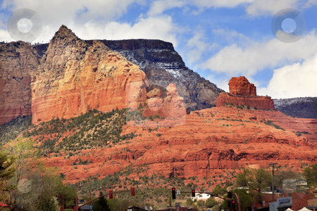 Ship Rock Butte Orange Red Canyon Sedona Arizona stock photo, Ship Rock  Butte Orange Red Canyon Houses Shopping Area, Red Lights, Blue Cloudy Sky Green Trees Sedona Arizona by William Perry