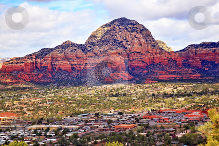 Capitol Butte Orange Red Rock Canyon West Sedona Arizona stock photo, Capitol Butte Orange Red Rock Canyon Houses, Shopping Malls, Blue Cloudy Sky Green Trees Snow West Sedona Arizona by William Perry