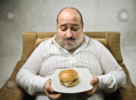 Diet stock photo, Sad fat man looking at a dish with a tiny hamburger on it by olly4