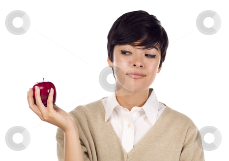 Pretty Hispanic Young Adult Female Looking at Apple stock photo, Pretty Hispanic Young Adult Female Looking at Apple in Hand Isolated on a White Background. by Andy Dean