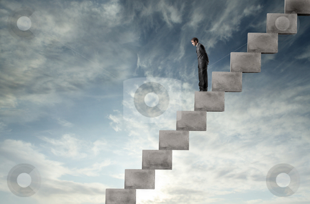 Descent stock photo, Businessman standing on a stairway and looking downwards by olly4
