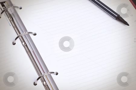 Blank Spiral Organizer Macro stock photo, Close-up image of blank spiral organizer with black marker pen by HypnoCreative