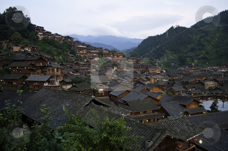 Old Chinese Village stock photo, A old miao chinese village with tradtional style houses by elemery