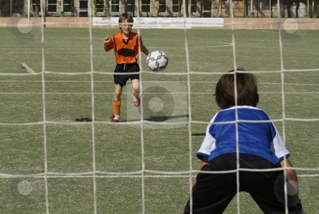 Kids playing football or soccer game stock photo, kids playing football or soccer game by mandygodbehear