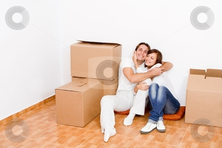 Young couple in new first home stock photo, young couple in new first home by mandygodbehear