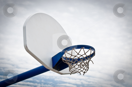 Playground Basketball Hoop and Backboard stock photo, A basketball hoop and backboard in an outdoor playground. by Brian Guest