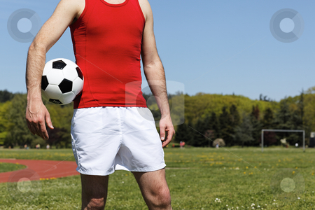 Man with a ball in park in summer stock photo, man with a ball in park in summer by vwalakte