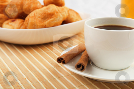 Breakfast coffee and croissants stock photo, Breakfast coffee and croissants on a table on a light background. by Sergey Nivens