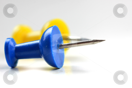 Two push pins stock photo, Close up shot of one yellow and one blue push pin by Sreedhar Yedlapati