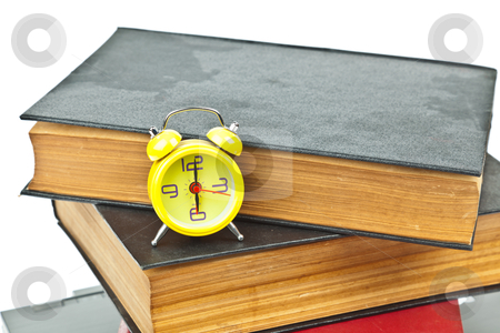Clock on book as time management concept stock photo, Clock on book as time management concept by FrameAngel