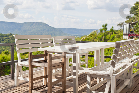 Dining table on terrace and, mountain view stock photo, Dining table on terrace and, mountain view by FrameAngel