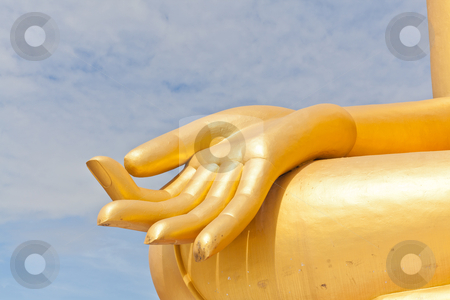 Big Golden Buddha hand statue in Thaland temple  stock photo, Big Golden Buddha hand statue in Thaland temple by FrameAngel