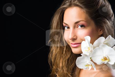 Gorgeous brunette closeup beauty shot. stock photo, Gorgeous brunette closeup beauty shot with white orchid. by exvivo