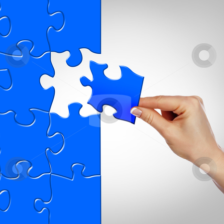Elements of the puzzle stock photo, Elements of the puzzle going into a whole. As a symbol of various business solutions. by Sergey Nivens