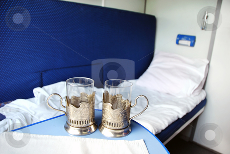 Traveling by train stock photo, empty glasses for tea and coach in train wagon by Julija Sapic