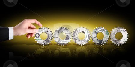 Business Savings Plan stock photo, A business man's hand turns gears made out of money by macropixel