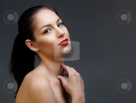 Beautiful woman with red lipstick stock photo, beautiful woman with long black hair in ponytail and shiny skin wearing classic red lipstick and beautiful skin texture by lubavnel