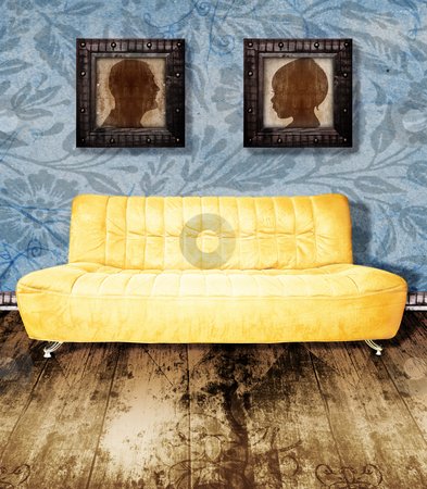Family portrait and couch on wallpaper stock photo, family portraits in grunge frames over a yellow couch against wallpaper background and wooden antique floor. by lubavnel
