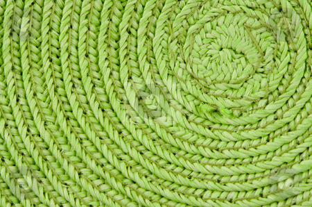 Circular background stock photo, Circular background from green rattan fibers. by Homydesign