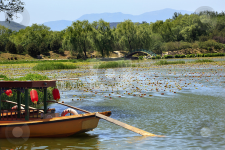 Boat Red Lanterns, Lake Yuanming Yuan Garden Old Summer Palace W stock photo, Yellow Boat Red Lantrns Yuanming Yuan Garden Lake Lily Pads Old Summer Palace Willows Beijing China by William Perry
