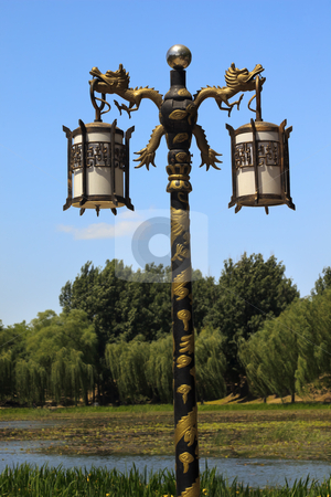 Ornate Dragon Lamp Post Yuanming Yuan Old Summer Palace Willows  stock photo, Ornate Golden Dragon Lamp Post Yuanming Yuan Old Summer Palace Willows Beijing China by William Perry